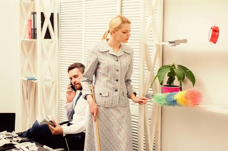 Personal assistant. Equal rights for education work and salary. Gender discrimination in business life. Woman cleaning up office while boss has phone conversation. Gender concept. Gender and career