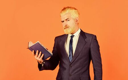 Feed the mind serious businessman hold notebook. mature man dyed beard and hair. reading book. check his notes. daily schedule. male professional teacher. after barbershop. business school education Reklamní fotografie