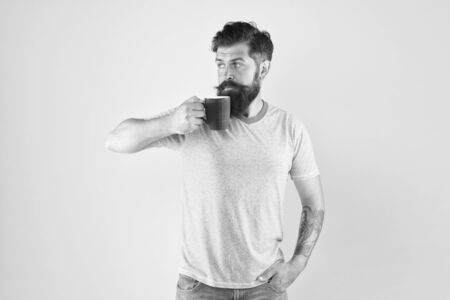 Tea time. Coffee with right proportion of milk. Morning habits lifestyle. Fanatic of coffee culture. Energy concept. Hipster barista yellow background. Coffee shop. Bearded man drink morning coffee Stock Photo