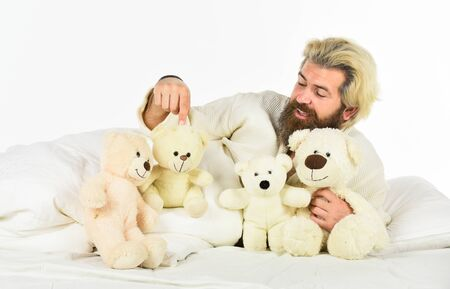 present toy. Handsome hipster hold lovely bear toy. Happy Valentines day. Sick man with flu lying in the bed. sleeping at home in bed with his toy. man sleeping in embrace with white teddy bear
