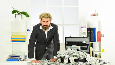 Money laundering. Business challenges. Accounting and banking. Financial success. Tax service. Financial expert. Taxation. Illegal profit. Man with briefcase full of cash. Financial achievement Stock Photo