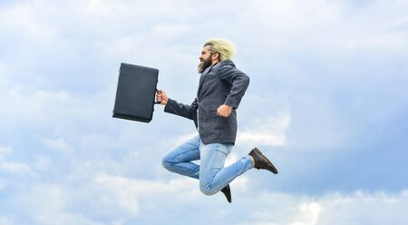 Happy worker. Freedom. Feeling free. Business man formal suit carries briefcase. Illegal deal business. Find your life mission. Businessman run away business case. Feel impact. Hipster hold briefcase Foto de archivo