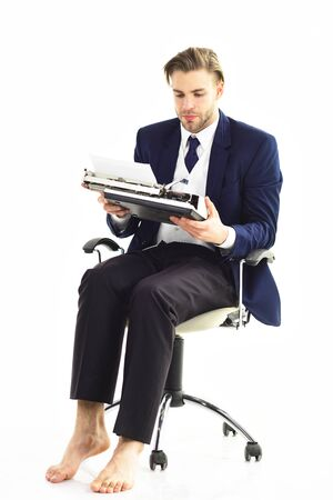 Workaholic, hard worker, paper work concept. Young businessman works with serious face. Standard-Bild