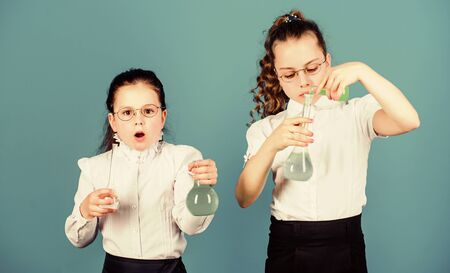 biology education. children study chemistry lab. back to school. school kid scientist studying science. little smart girls with testing flask. Committed to find the cure