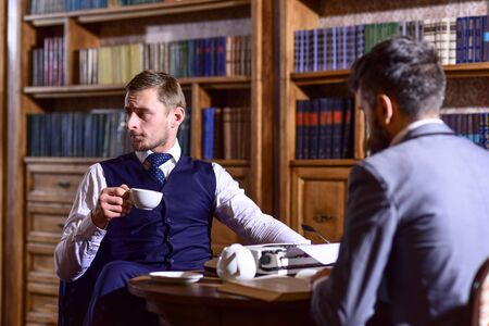 Aristocrats spend leisure in intelligent company. Tea party concept. Foto de archivo