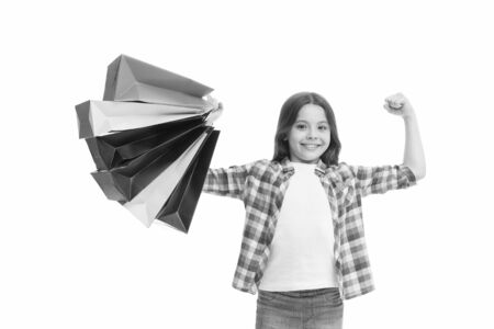 Shopping is my superpower. Happy child with paper bags. Little girl smile with shopping bags. Holiday preparation and celebration. Shopping and sale on black friday. Seasonal discount. Bachelor day