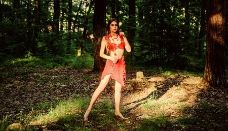 Temptation. sexy girl in leather clothes. cougar female. ethnic tribal fashion. deep forest. amazon woman. sexy witch. wild woman in forest. Sexy reality. character costume.