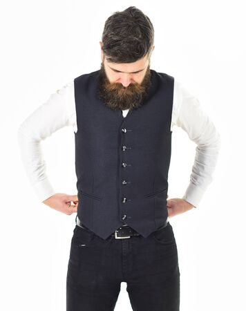 Sad bearded man with hands in pockets