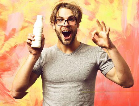 Caucasian bearded sexy macho man holding bottle of milk