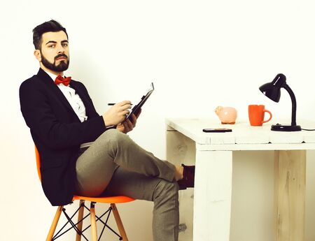 Bearded man, caucasian hipster with moustache at white wooden table Banco de Imagens