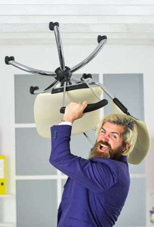 Furniture sale. Get rid of the excess. Businessman standing in office hold chair. Business man aggressive. Hipster man angry with office chair. Throw out chair. Stress concept. Crazy or mad