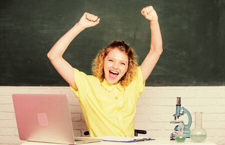 biology experiment. make notes about chemistry research results. happy student with microscope and beaker. scientist teacher at school lab. girl in classroom laboratory with computer. happiness