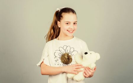 little girl playing game in playroom. toy shop. childrens day. Best friend. playground in kindergarten. happy childhood. Birthday. small girl with soft bear toy. child psychology. Enjoying playtime