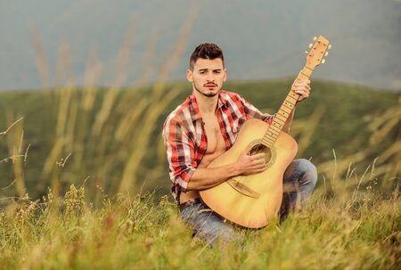 cowboy man with acoustic guitar 版權商用圖片