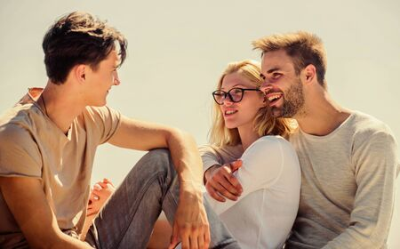 Being sincere with closest people. Men and woman talking sky background. Spending time with friends. Summer vacation. Discussing ideas. Friends relaxing on roof. Carefree friends. True friendship