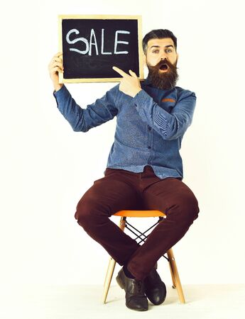 Bearded man, brutal caucasian hipster with moustache holding sale inscription 版權商用圖片