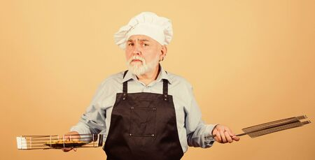 Perfect picnic. prepare dinner for family. Family weekend. senior man in chef hat. cook men with beard. cooking utensils for barbecue. he prefer grill food. Picnic and barbecue. Kitchen rules Фото со стока