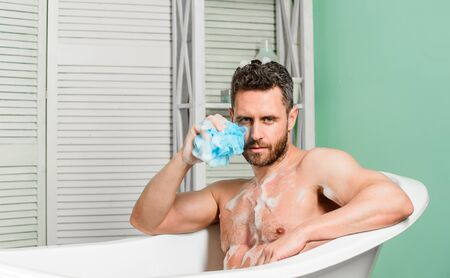 personal care. Sexy man in bathroom. desire and temptation. hygiene and health. Morning shower. macho man washing in bath. man wash muscular body with foam sponge. Perfect body