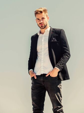 Bearded guy business style. macho man. male grooming. formal male fashion. modern lifestyle. confident businessman. Handsome man fashion model. success concept. Sky background. agile business