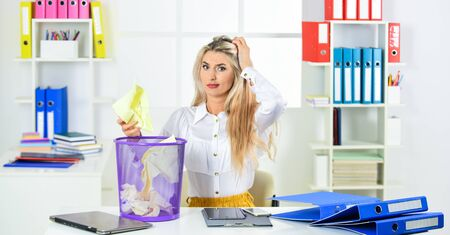 Cancel file deletion. Dispose of waste paper. Paper recycling. Crumpled paper in basket. Woman hold garbage bin. Businesswoman hold trash can. Girl looking for lost document. Lost due to distraction Stockfoto