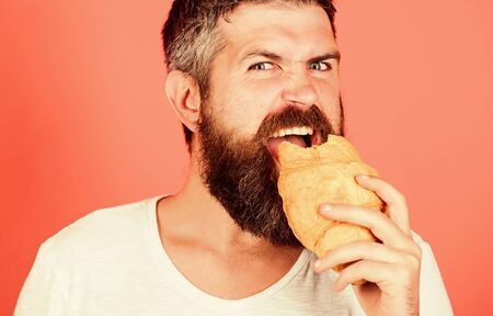 Delicious breakfast. Unhealthy but yummy breakfast. Perfect match. feel hunger. Bearded hipster enjoy breakfast. Morning tradition concept. Fresh baked croissant. hungry hipster bite croissant