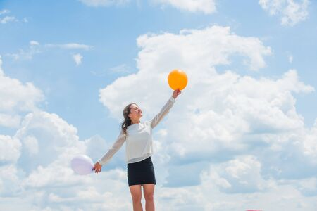 little kid in spring holiday. cheerful child have fun. happy birthday party. small girl with party balloon. summer holidays and vacation. childhood happiness. free and carefree. Girls going crazy