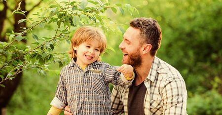 Feed your baby. Natural nutrition concept. Dad and cute toddler boy having lunch outdoors. Child care. Feeding son natural foods. Feed in right way for childs stage of development. Feed son solids