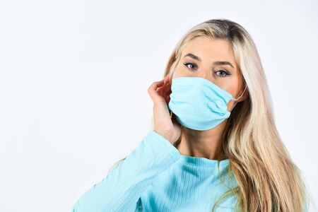 Face mask become fashion accessory. Quarantine and infection spreading. Safety measures. Virus outbreak. Modern fashion. Matching clothes. Girl wear blue suit and face mask. Protective mask