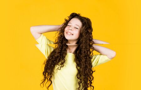 fashion and beauty. small girl in hairdresser beauty salon. little happy kid has very curly hair. hairstyle for kids. looking beautiful and trendy. long and healthy hair. Everything must be perfect Stock fotó - 150297668