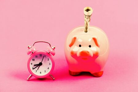 Banking account. Bankruptcy and debt. Pay for debt. Bank collector service. Economics and finance. It is time to pay. Piggy bank stuffed dollar cash and alarm clock. Financial crisis. Credit debt. Stok Fotoğraf
