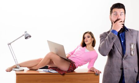 Office manager or secretary. Sexy personal secretary. Full of desire. Sexy lady worker attractive legs sit table. Boss excited about sexy secretary. Temptress relaxing on table. Resist temptation