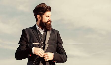 Fashion trend. Guy beard and mustache wear formal clothes. Just right. Businessman bearded face sky background. Flawless outfit. Man formal suit adjusting jacket. Male fashion formal menswear.