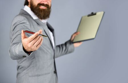 Confident businessman holding folder for documents. business people and corporate concept. caucasian businessman with folder at office. portrait of bearded man making notes. copy space. Banco de Imagens