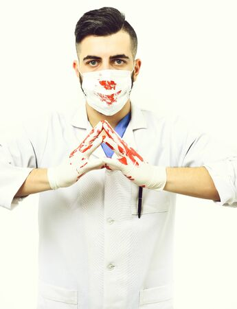 Doctor in white coat and surgical mask stained with blood Banco de Imagens
