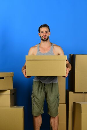 Man standing among cardboard boxes 스톡 콘텐츠