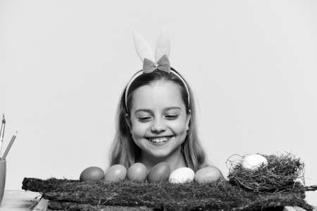 small happy baby girl with easter eggs isolated on white Stok Fotoğraf
