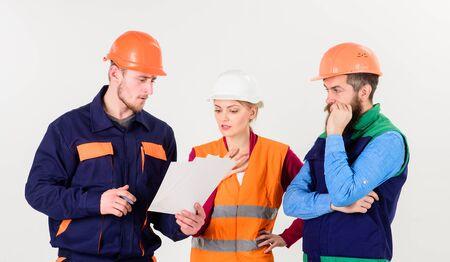 Labor dispute concept. Builders and engineer arguing, misunderstanding.