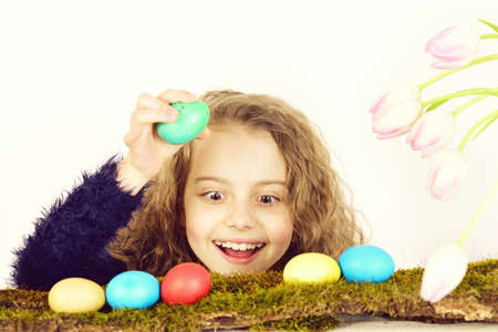 happy smiling easter girl with colorful eggs and tulip flowers Stok Fotoğraf
