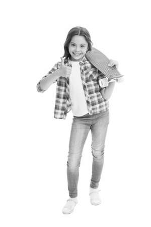 Ideal for short distance ride. Happy skater show thumbs up isolated on white. Little child hold penny board. Small skateboarder with penny skateboard. Riding penny board. Penny board for beginner