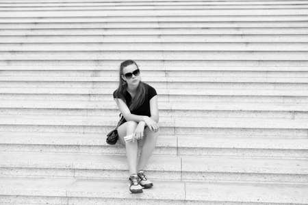 Tourist guide sightseeing excursion. Vacation ideas. Vacation in big city. Woman relaxing. Museum open hours. Girl tourist sit and wait on stairs. Ready explore city. Vacation and travel concept