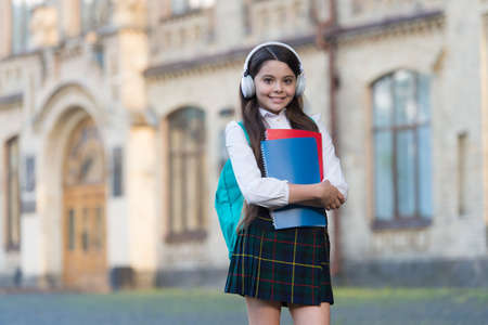 Audio technology. Happy child wear audio headphones. Audio educational media. Listening comprehension. Audio books for learning. School and education. Modern life