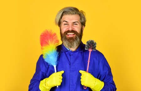 I am busy. cleaning service. housekeeping business. Cleaning the apartment. man use pp duster. hipster holding the cleaning tool. cleaning and home concept. Male Sweeping with small duster broom