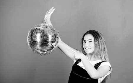 happy birthday party. disco dancing. celebrating the holiday. girl with disco ball. christmas holiday. event manager. party goer. lets dance. night life concept. ready for having fun. Party fun