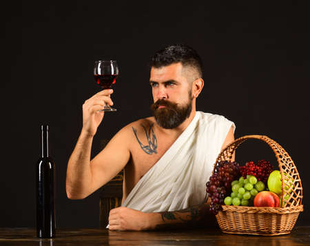 Winemaking and degustation concept. God Bacchus with attentive face Banco de Imagens