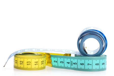 Yellow and blue rolled measuring tapes isolated on white background. Rolled centimeter rulers. Measuring tapes of tailor with indicators in form of centimeters. Handicraft and tailoring concept.