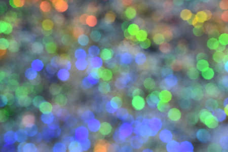 Christmas wallpaper decorations concept. Background of colorful bulb lights. Holiday festival backdrop with sparkling lights. Defocused and abstract colourful bokeh with night light.