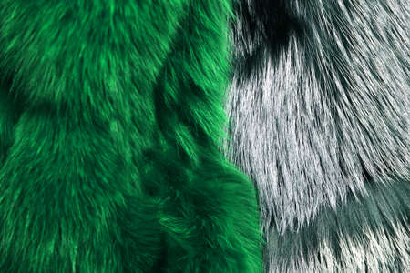 Luxury and elegant fluffy clothes. Artificial fur for texture or background. Dyed furry coat in green and grey color, close up. Eco friendly fashion concept.