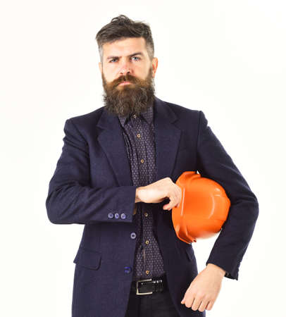 Man with beard and serious face. Architect controls work.