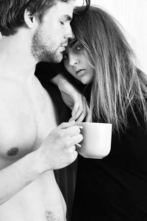 couple of bearded man with cute sexy girl holding cup 免版税图像