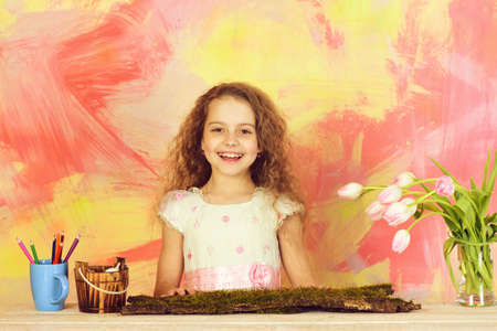 happy girl painter with pencil, tulip flowers, mothers day holiday